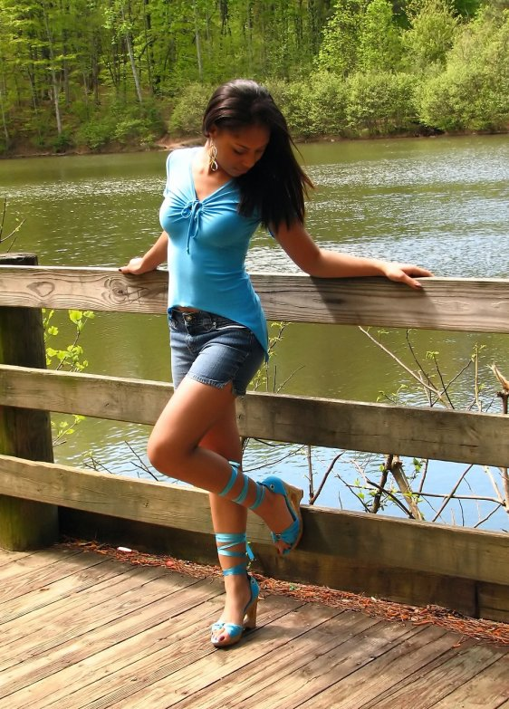 5011-portrait-of-a-beautiful-african-american-teen-girl-posing-against-a-wood-pv